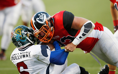 North's Jerome Holloway is tackled by South's Colt Doughty in the fourth quarter during the Charlie Wedemeyer high school all-star football game at Levi's Stadium in Santa Clara, Calif., on Saturday, July 16, 2016. (Jim Gensheimer/Bay Area News Group)