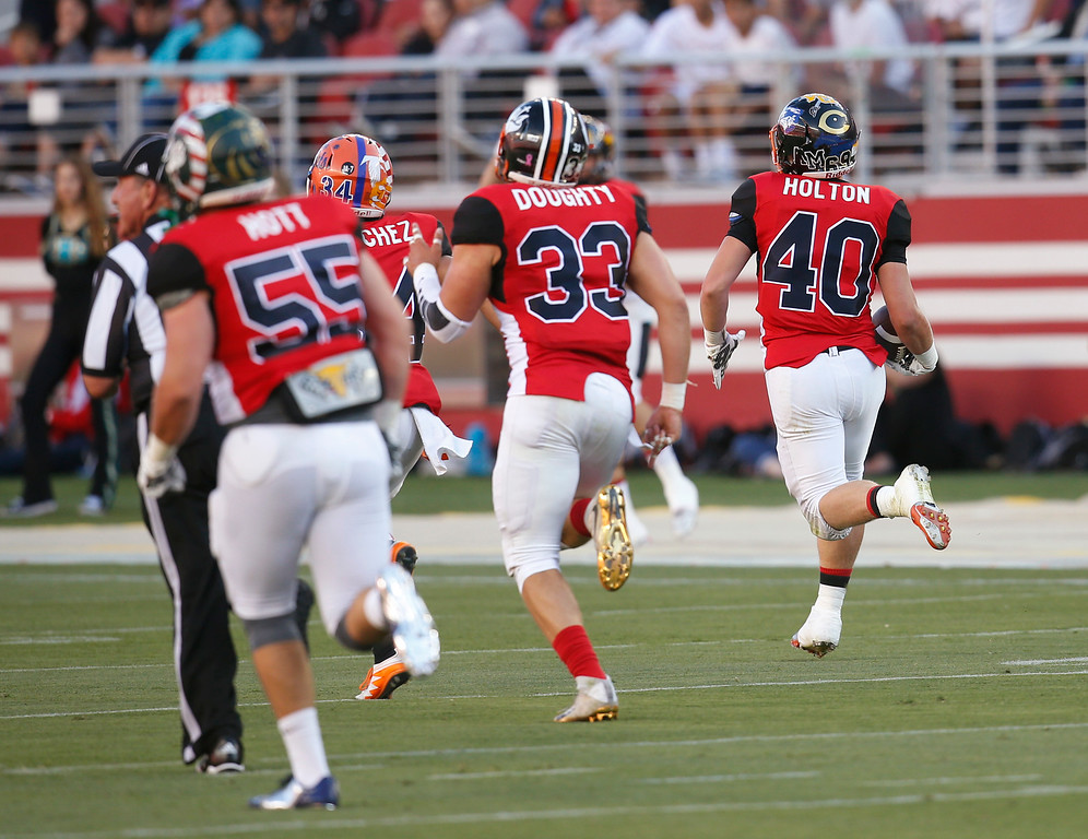 . South\'s Jake Holton runs back an interception for a touchdown against the North in the second quarter during the Charlie Wedemeyer high school all-star football game at Levi\'s Stadium in Santa Clara, Calif., on Saturday, July 16, 2016. (Jim Gensheimer/Bay Area News Group)