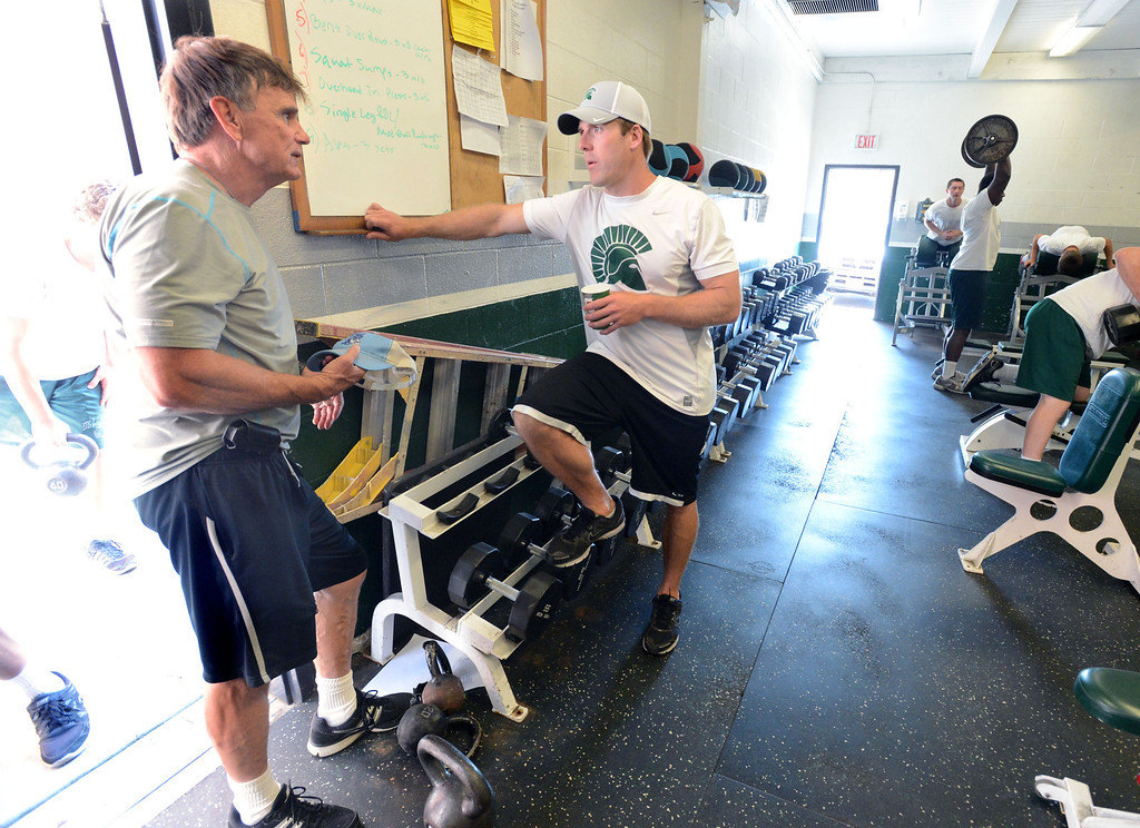 . De La Salle High\'s former head football coach Bob Ladouceur, left, talks to the new head football coach Justin Alumbaugh, in the school\'s training room after practice in Concord, Calif., on Friday, Aug. 9, 2013. Alumbaugh takes over the state\'s most elite high school football program from the reins of the legendary Ladouceur, who retired this spring after 33 years. (Doug Duran/Bay Area News Group)
