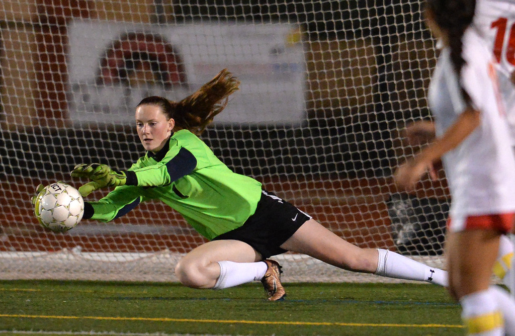 . Monte Vista High goalkeeper Sarah Mondloch (1) blocks a shot in the first half of their soccer game against San Ramon Valley High in Danville, Calif., on Tuesday, Jan. 19, 2016. (Doug Duran/Bay Area News Group)