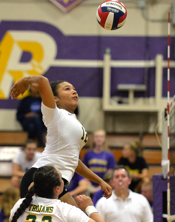 . Castro Valley High\'s Marbella Daniel (12) gets ready to spike the ball during their non-conference game against Amador Valley High in Pleasanton, Calif., on Wednesday, Aug. 31, 2016. Castro Valley High went on to win the match in three straight sets. (Doug Duran/Bay Area News Group)