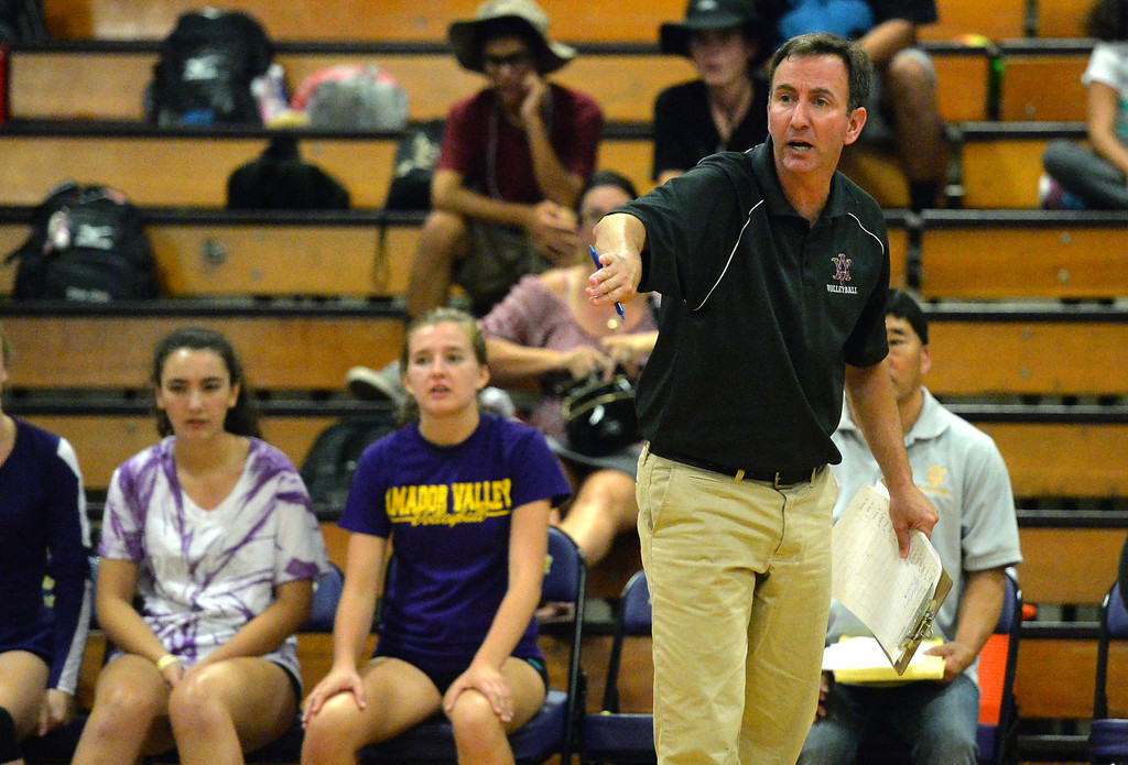 . Amador Valley High volleyball coach Gary Reznick talks to his players during their non-conference game against Castro Valley High in Pleasanton, Calif., on Wednesday, Aug. 31, 2016. Castro Valley High went on to win the match in three straight sets. (Doug Duran/Bay Area News Group)