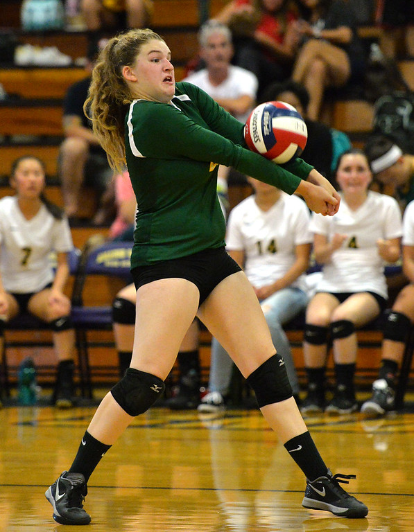 . Castro Valley High\'s Margaret DelGrande (20) passes the ball during their non-conference game against Amador Valley High in Pleasanton, Calif., on Wednesday, Aug. 31, 2016. Castro Valley High went on to win the match in three straight sets. (Doug Duran/Bay Area News Group)