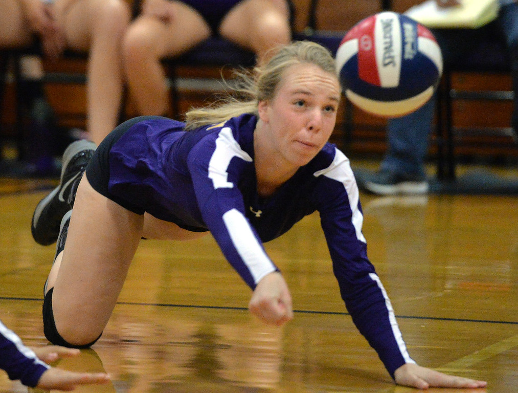 . Amador Valley High\'s Natalie Lambros (2) dives for the ball during their non-conference game against Castro Valley High in Pleasanton, Calif., on Wednesday, Aug. 31, 2016. Castro Valley High went on to win the match in three straight sets. (Doug Duran/Bay Area News Group)