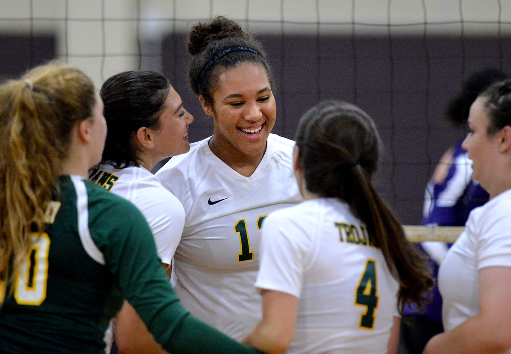 . Castro Valley High\'s Marbella Daniel (12) celebrates with teammates after scoring a point during their non-conference game against Amador Valley High in Pleasanton, Calif., on Wednesday, Aug. 31, 2016. Castro Valley High went on to win the match in three straight sets. (Doug Duran/Bay Area News Group)