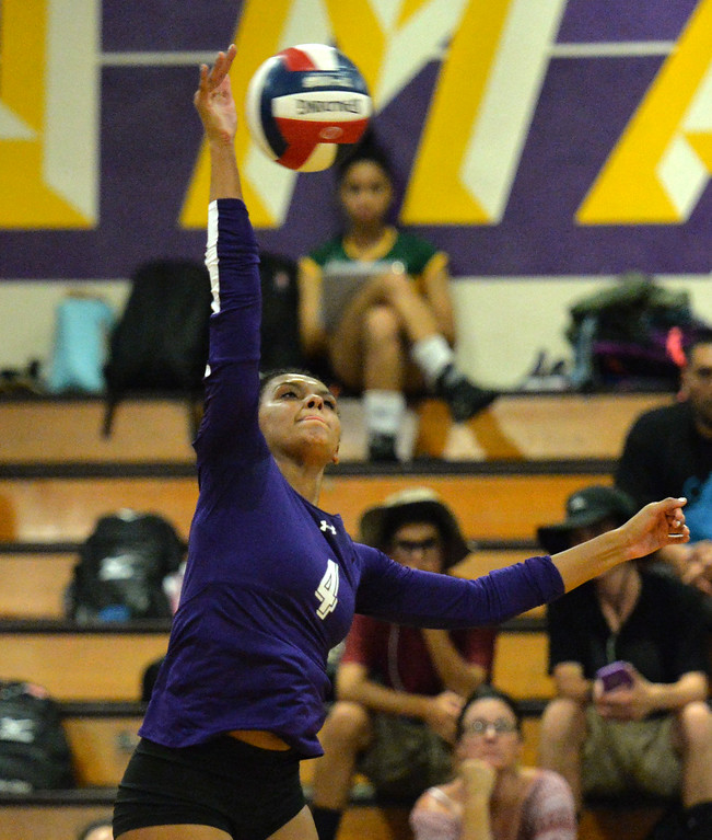 . Amador Valley High\'s Mahlia Jackson (4) takes a shot  during their non-conference game against Castro Valley High in Pleasanton, Calif., on Wednesday, Aug. 31, 2016. Castro Valley High went on to win the match in three straight sets. (Doug Duran/Bay Area News Group)