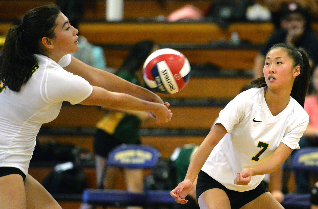 . Castro Valley High\'s Nikki Jensen (3), left, passes the ball as teammate Nikki Zing (7) watches during their non-conference game against Amador Valley High in Pleasanton, Calif., on Wednesday, Aug. 31, 2016. Castro Valley High went on to win the match in three straight sets. (Doug Duran/Bay Area News Group)