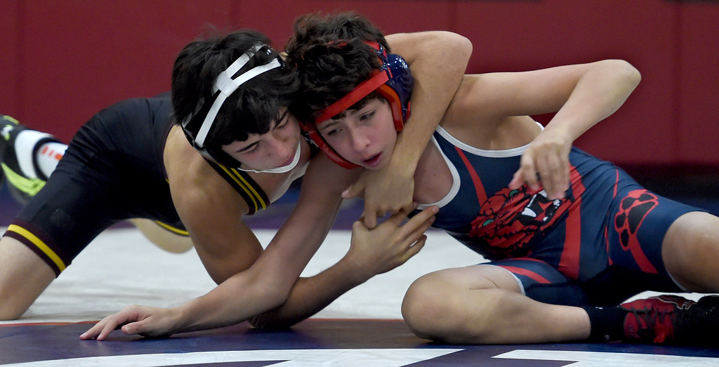 . Las Lomas\' Jake Gaitan, left, and Campolindo\'s Tomas Martinho compete in the 106-pound weight class during a Diablo Foothill Athletic League dual meet wrestling match at Las Lomas High School in Walnut Creek, Calif., on Wednesday, Jan 6, 2016. (Susan Trip Pollard/Bay Area News Group)