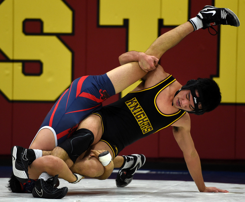 . Las Lomas\' Mutsu Osoegawa, right, wrestles Campolindo\'s Kennit Winden in the 152-pound weight class during a Diablo Foothill Athletic League dual meet wrestling match at Las Lomas High School in Walnut Creek, Calif., on Wednesday, Jan 6, 2016. (Susan Tripp Pollard/Bay Area News Group)