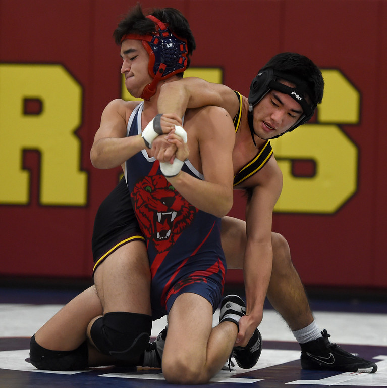 . Campolindo\'s Kennit Winden, left, and Las Lomas\' Mutsu Osoegawa wrestle in the 152-pound weight class during a Diablo Foothill Athletic League dual meet wrestling match at Las Lomas High School in Walnut Creek, Calif., on Wednesday, Jan 6, 2016. (Susan Trip Pollard/Bay Area News Group)