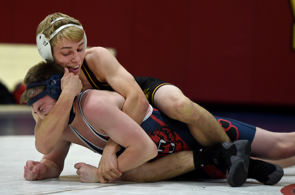 . Las Lomas\' Jeff Caldwell, top, wrestles Campolindo\'s Peyton Manty in the 138-pound weight class during a Diablo Foothill Athletic League dual meet wrestling match at Las Lomas High School in Walnut Creek, Calif., on Wednesday, Jan 6, 2016. (Susan Trip Pollard/Bay Area News Group)
