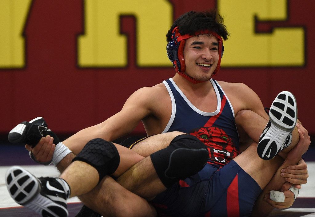 . Campolindo\'s Kennit Winden smiles while wrestling Las Lomas\' Mutsu Osoegawa during a Diablo Foothill Athletic League dual meet wrestling match at Las Lomas High School in Walnut Creek, Calif., on Wednesday, Jan 6, 2016. Osoegawa went on to pin Winden in 4:41. (Susan Trip Pollard/Bay Area News Group)