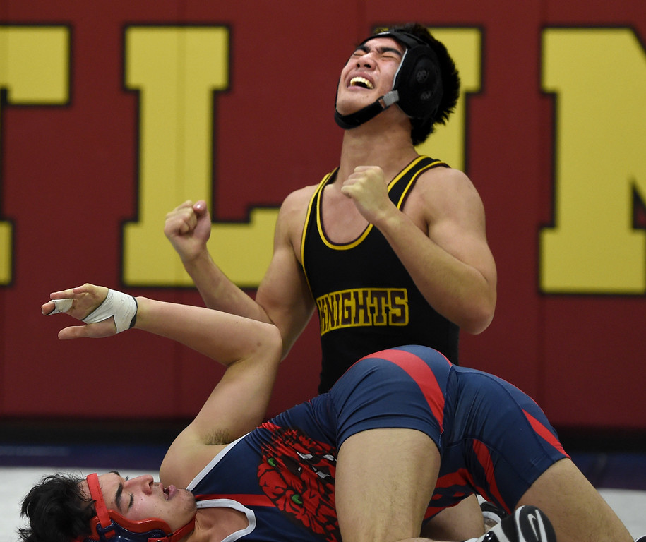 . Campolindo\'s Kennit Winden looks up at Las Lomas\' Mutsu Osoegawa after Osoegawa pins Winden in 4:41 during a Diablo Foothill Athletic League dual meet wrestling match at Las Lomas High School in Walnut Creek, Calif., on Wednesday, Jan 6, 2016. (Susan Trip Pollard/Bay Area News Group)