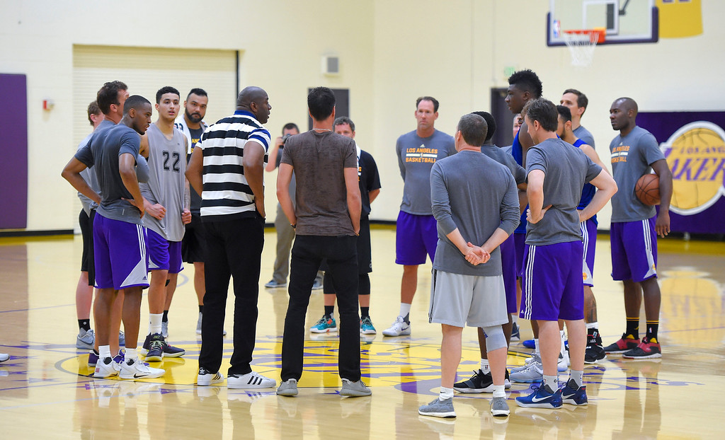 . Magic Johnson, president of basketball operations for the Los Angeles Lakers, in striped shirt, chats with staff members and draft prospects following a workout in El Segundo on Monday, May 22, 2017. The Lakers brought in several players to evaluate for their 28th pick in the first round of the upcoming NBA draft. (Photo by Scott Varley, Daily Breeze/SCNG)
