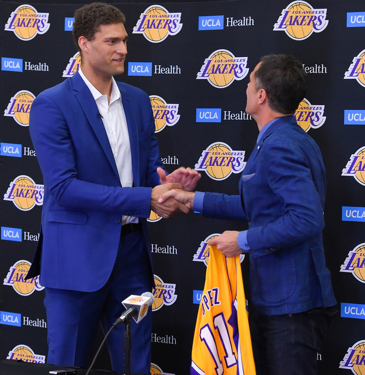 . Rob Pelinka, general manager for the Lakers, right, welcomes new center Brook Lopez in El Segundo on Wednesday, June 28, 2017. The Lakers acquired Lopez and forward Kyle Kuzma from the Brooklyn Nets in exchange for Timofey Mozgov and D�Angelo Russell. (Photo by Scott Varley, Daily Breeze/SCNG)