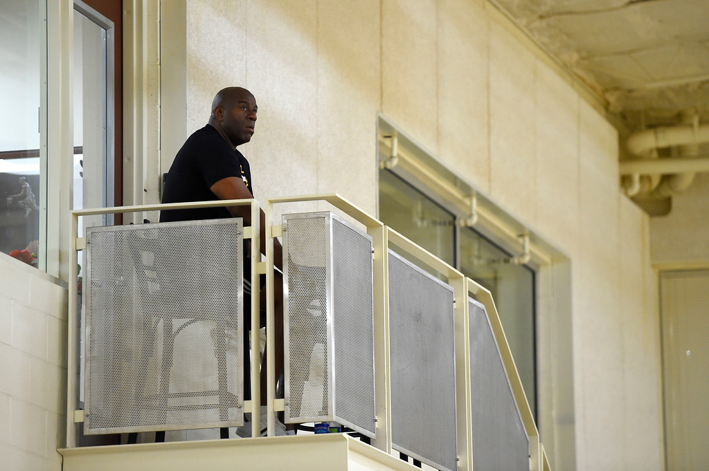 . Lakers GM Magic Johnson watches his rookies practice from atop a staircase in El Segundo on Wednesday, July 5, 2017. The newest Lakers players are getting ready for Summer League games starting Friday in Las Vegas. (Photo by Scott Varley, Daily Breeze/SCNG)