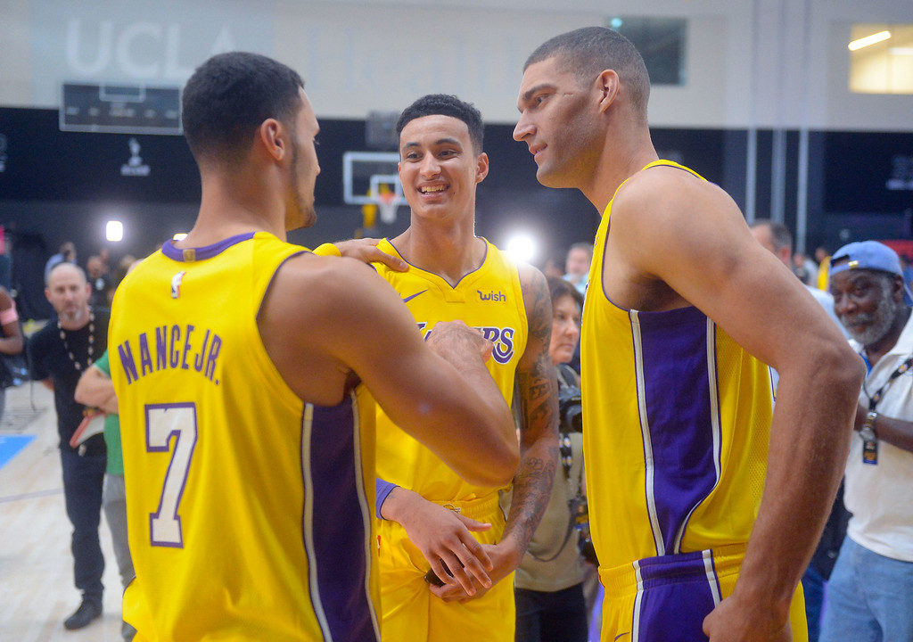 . From left, Larry Nance, Jr., Kyle Kuzma and Brook Lopez chat during the Lakers media day event at their new training facility in El Segundo on Monday, September 25, 2017. (Photo by Scott Varley, Daily Breeze/SCNG)