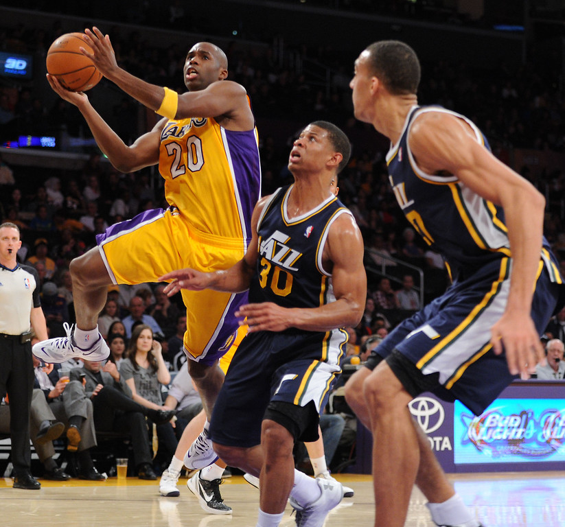 . Los Angeles Laker Jodie Meeks goes to the basket against the Utah Jazz\'s Scott Machado in the NBA preseason basketball game at Staples Center in Los Angeles, CA. on Tuesday, October 22, 2013. (Photo by Sean Hiller/Daily News)