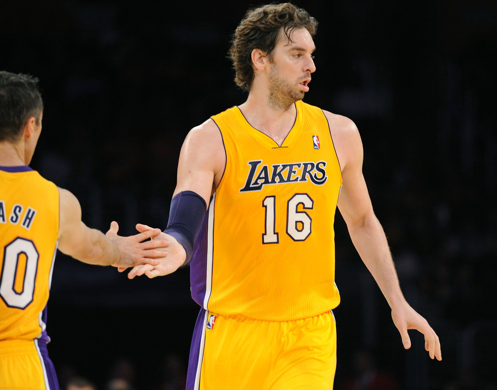. Los Angeles Lakers Steve Nash and Pau Gasol celebrate a play against the Utah Jazz in the NBA preseason basketball game at Staples Center in Los Angeles, CA. on Tuesday, October 22, 2013. (Photo by Sean Hiller/Daily News)