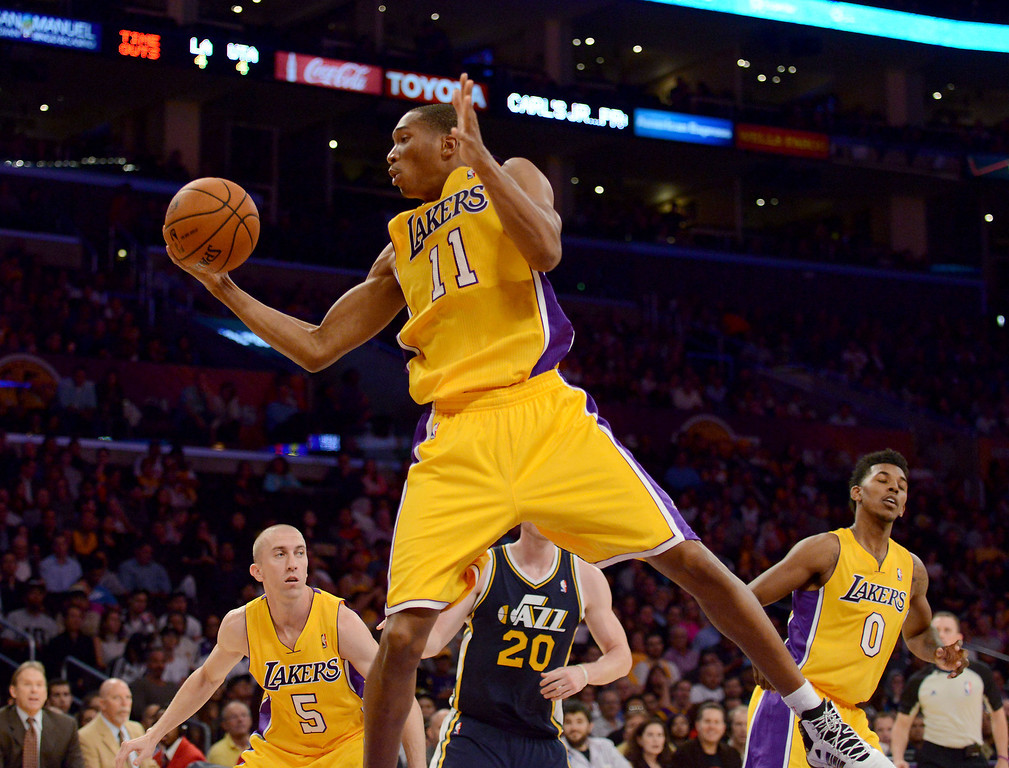 . Los Angeles Laker Wesley Johnson grabs a rebound against the Utah Jazz first half in the NBA preseason basketball game at Staples Center in Los Angeles, CA. on Tuesday, October 22, 2013. (Photo by Sean Hiller/Daily News)