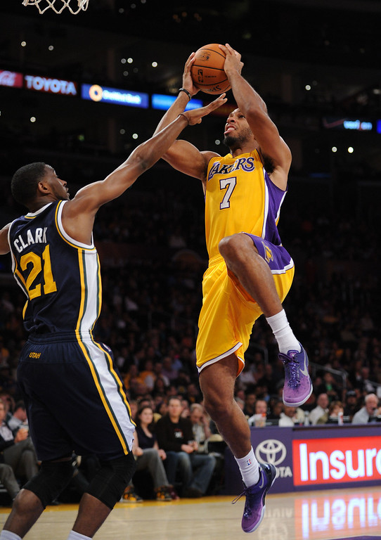 . Los Angeles Laker Xavier Henry goes against the Utah Jazz\'s Gordon Hayward in the NBA preseason basketball game at Staples Center in Los Angeles, CA. on Tuesday, October 22, 2013. (Photo by Sean Hiller/Daily News)