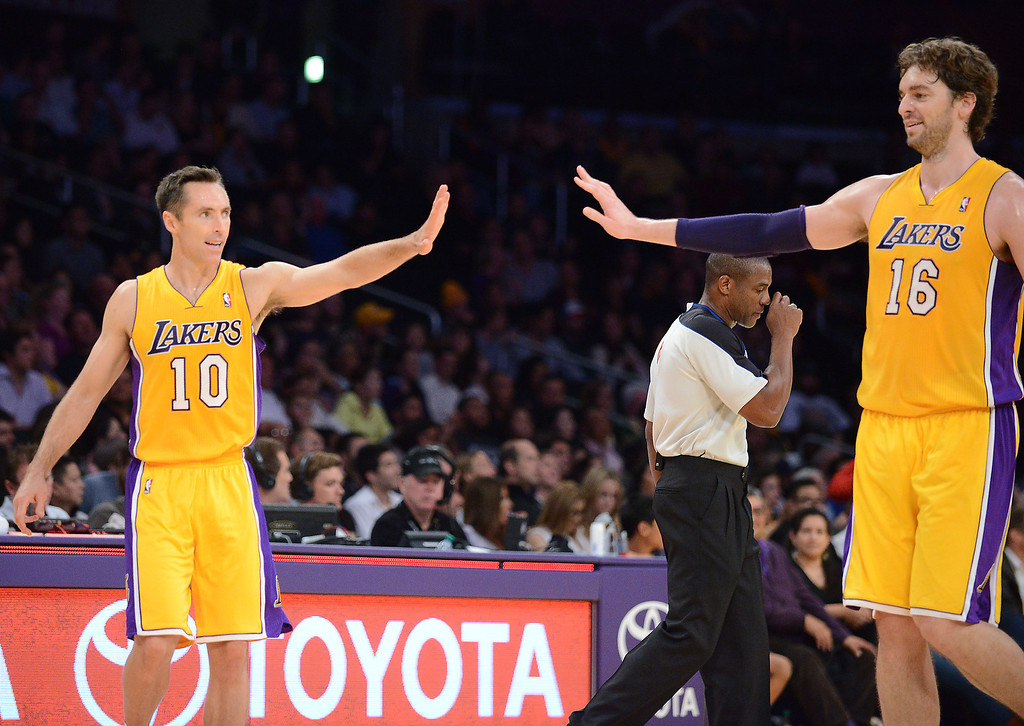 . Los Angeles Lakers Steve Nash and Pau Gasol celebrate after the first half against the Utah Jazz in the NBA preseason basketball game at Staples Center in Los Angeles, CA. on Tuesday, October 22, 2013. (Photo by Sean Hiller/Daily News)