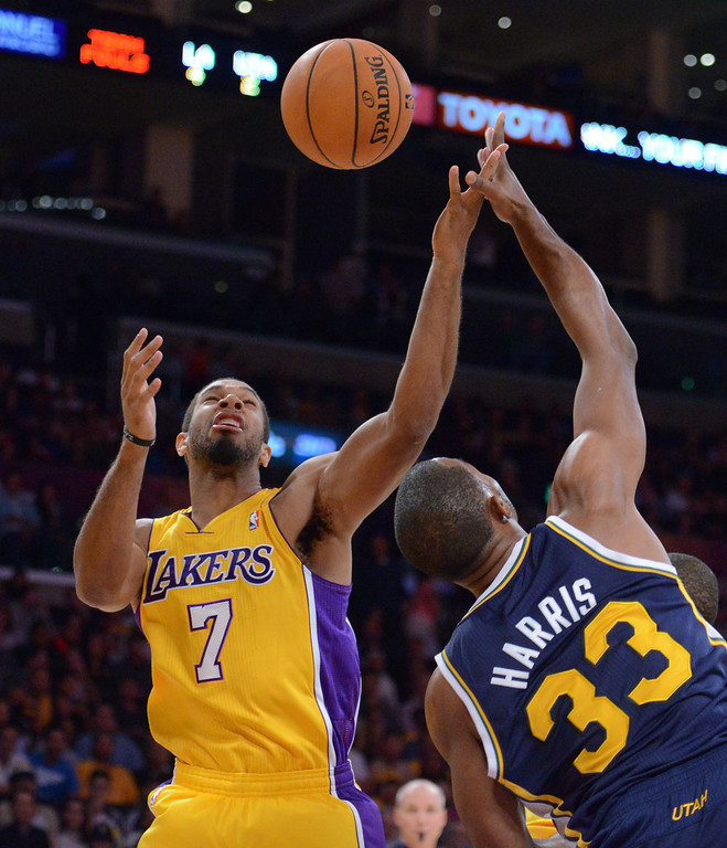 . Los Angeles Laker Xavier Henry battles Utah Jazz\'s Mike Harris first half in the NBA preseason basketball game at Staples Center in Los Angeles, CA. on Tuesday, October 22, 2013. (Photo by Sean Hiller/Daily News)