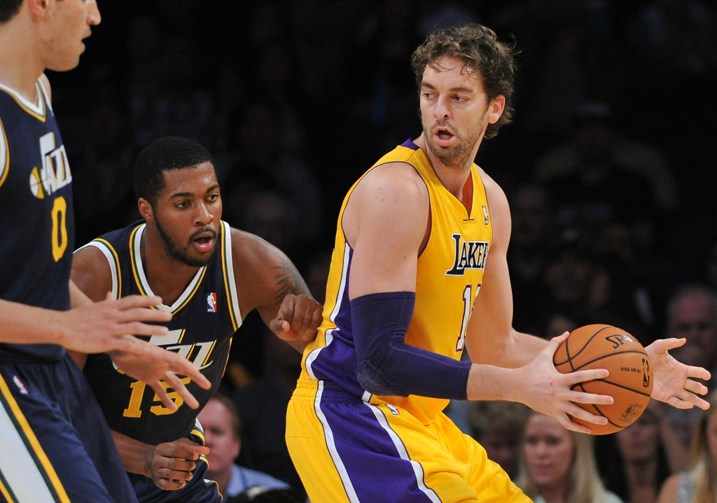 . Los Angeles Laker Pau Gasol battles Derrick Favors of the Utah Jazz in the NBA preseason basketball game at Staples Center in Los Angeles, CA. on Tuesday, October 22, 2013. (Photo by Sean Hiller/Daily News)