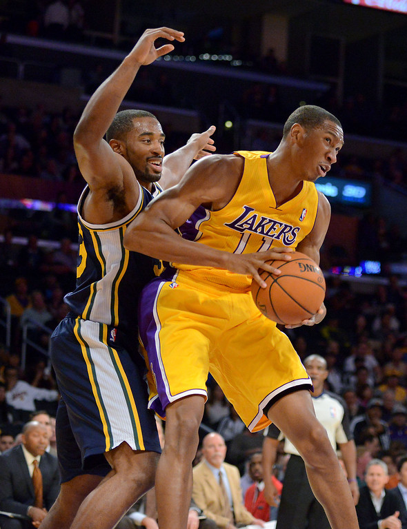 . Los Angeles Laker Wesley Johnson grabs a rebound over Utah Jazz\'s Mike Harris first half in the NBA preseason basketball game at Staples Center in Los Angeles, CA. on Tuesday, October 22, 2013. (Photo by Sean Hiller/Daily News)