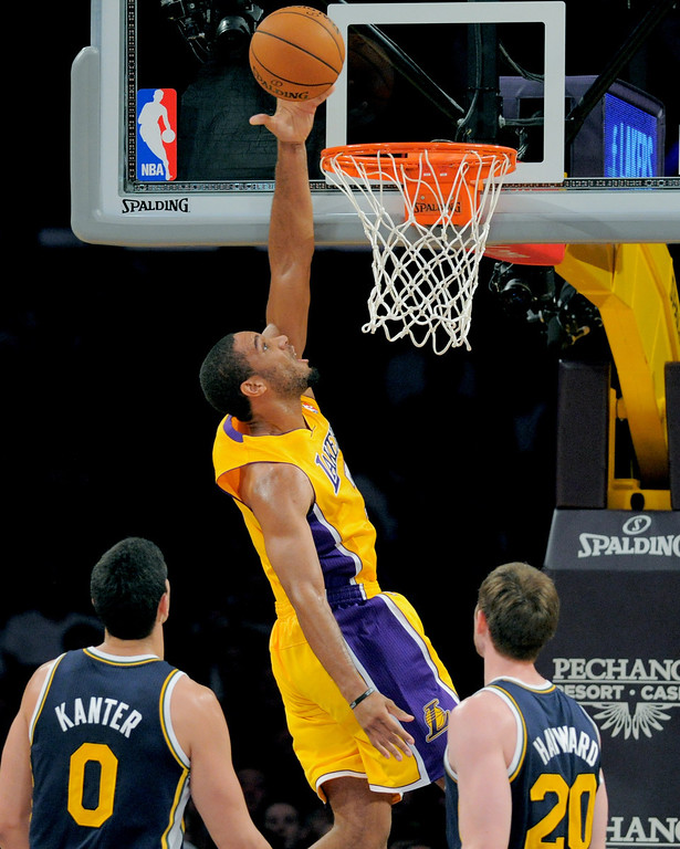 . Los Angeles Laker Xavier Henry sails to the basket against the Utah Jazz\'s Enes Kanter, left, and Gordon Hayward in the NBA preseason basketball game at Staples Center in Los Angeles, CA. on Tuesday, October 22, 2013. (Photo by Sean Hiller/Daily News)