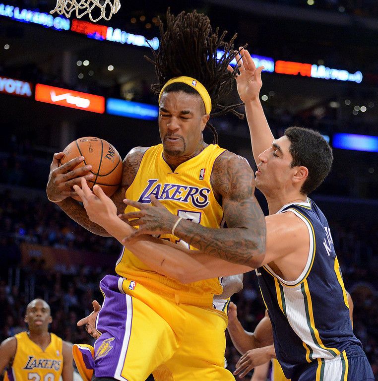 . Los Angeles Laker Jordan Hill wrestles a rebound from Utah Jazz\'s Enes Kanter first half in the NBA preseason basketball game at Staples Center in Los Angeles, CA. on Tuesday, October 22, 2013. (Photo by Sean Hiller/Daily News)