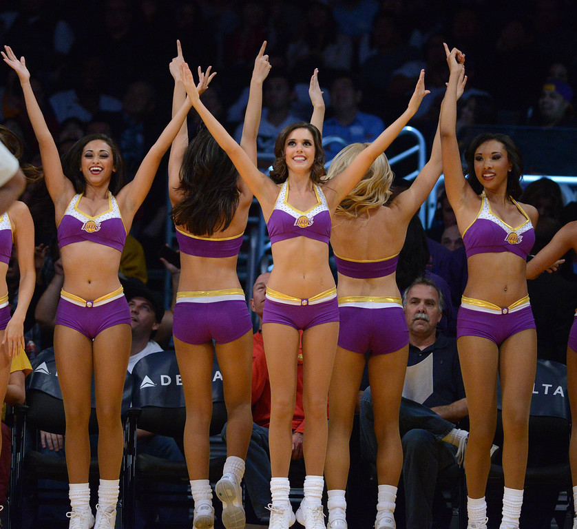 . Los Angeles Laker girls cheer as the Lakers host the Utah Jazz in the NBA preseason basketball game at Staples Center in Los Angeles, CA. on Tuesday, October 22, 2013. (Photo by Sean Hiller/Daily News)