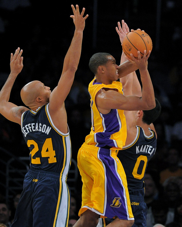 . Los Angeles Laker Wesley Johnson battles to the basket against the Utah Jazz\'s Richard Jefferson, left, and Enes Kanter in the NBA preseason basketball game at Staples Center in Los Angeles, CA. on Tuesday, October 22, 2013. (Photo by Sean Hiller/Daily News)