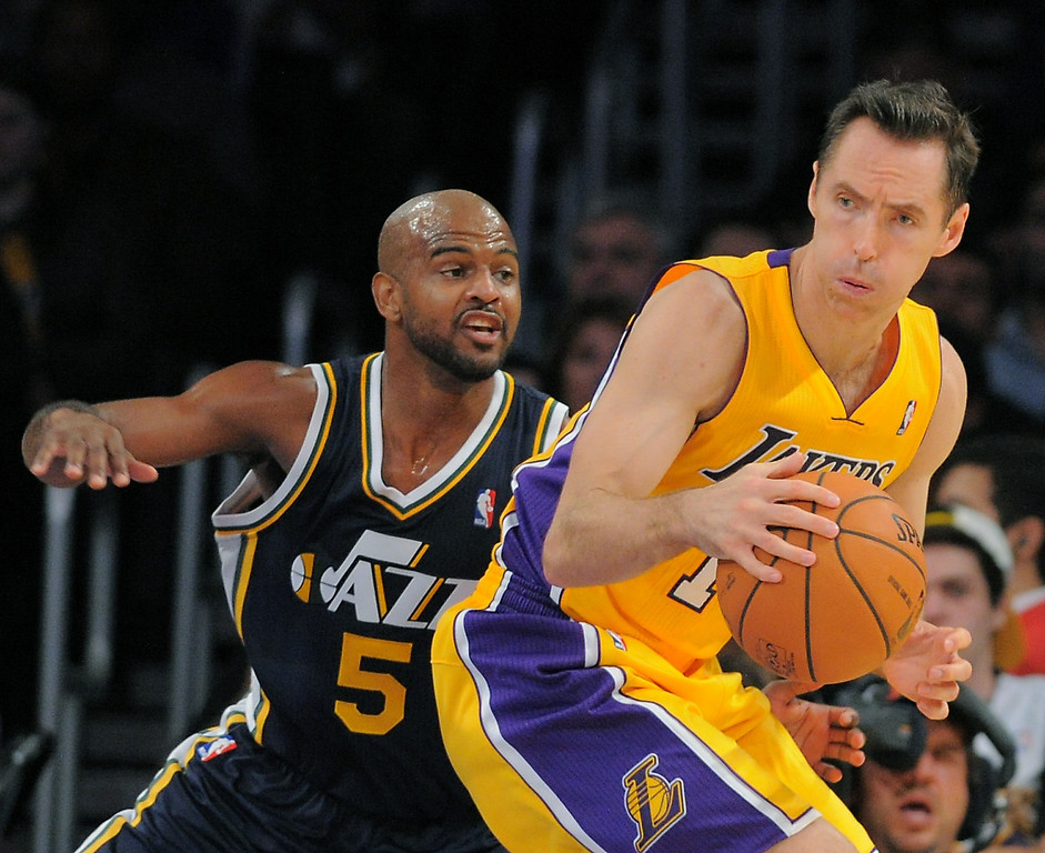 . Los Angeles Laker Steve Nash battles the Utah Jazz\'s John Lucas lll in the NBA preseason basketball game at Staples Center in Los Angeles, CA. on Tuesday, October 22, 2013. (Photo by Sean Hiller/Daily News)