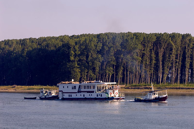 Floating hotel being pulled along Bratul Sfantu Gheorghe, Mahmudia, The Danube Delta, Dobrogea, Romania