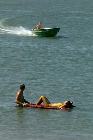Young people relaxing on the bank of Bratul Sfantu Gheorghe, Mahmudia, The Danube Delta, Dobrogea, Romania