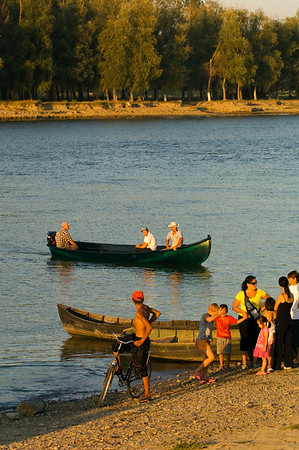 Local people meet and chat by the river, Mahmudia, The Danube Delta, Dobrogea, Romania