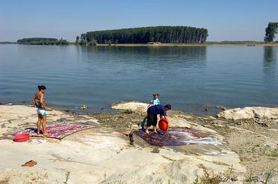 Local women cleaning carpets by th Danube River, Mahmudia, The Danube Delta, Dobrogea, Romania