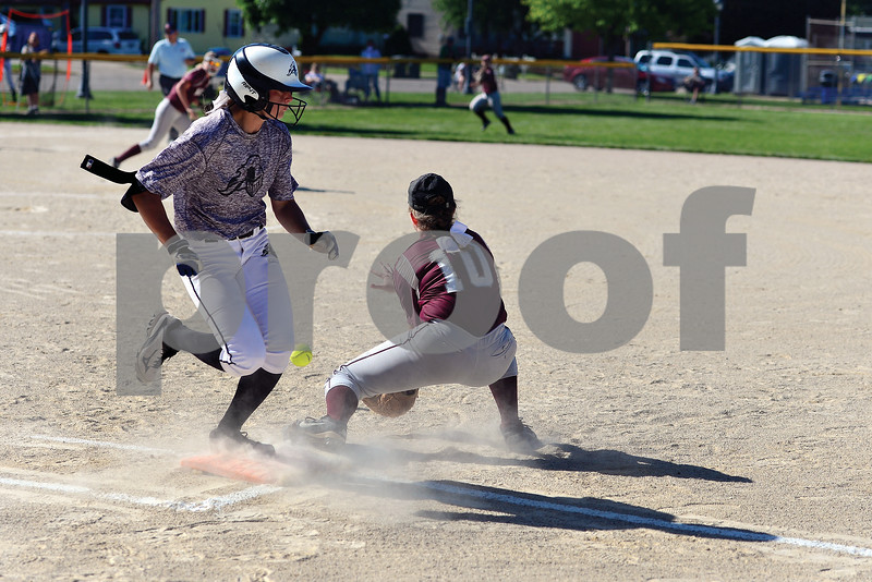 Kaneland's Alyson Jesionowski beats out an infield hit in the first inning.