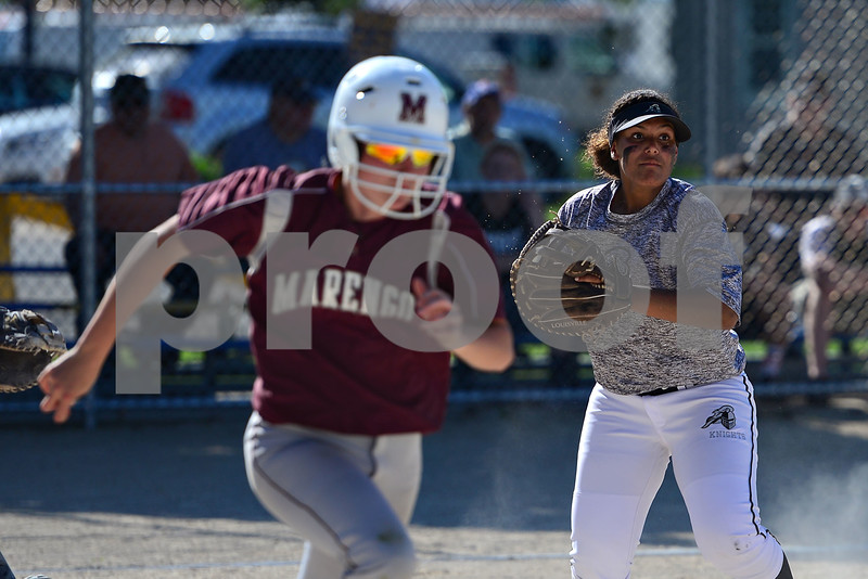 Kaneland's Hannah Theobald fires to first for an out.