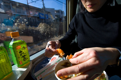 Japanese ladies are having a lunch (traditional ekibento) on the train to Matsumoto from Tokyo, Japan