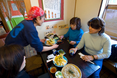 Japanese ladies are having lunch in Sobaya restaurant/bar; soba, udon and tempura, sake and beer are served