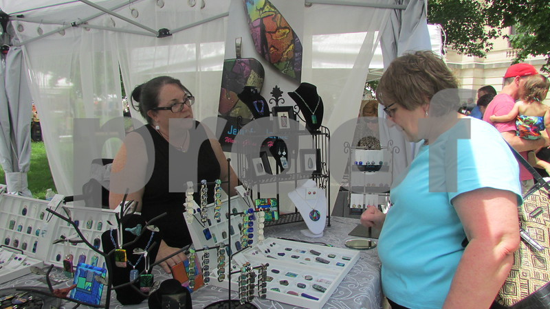 Aimee Barrows for Shaw Media<br /> Cheryl Smith of Sycamore chats with artist Carol Musial during the art show.