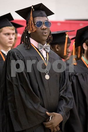 Sam Buckner for Shaw Media.<br /> Justin Diggs waits on the Victor E. court at the Convocation Center along with his classmates before heading into the ceramony on Saturday June 3, 2017.