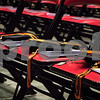 Sam Buckner for Shaw Media.<br /> Three caps and medals are set out on chairs in honor of the three students in the DHS class of 2017 who lost their lives while attending high school. One of those students Johnathon Ode met the graduation requirements in December and his diploma was presented to his father Stephen Ode, a teacher at DeKalb High School.