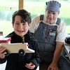 Brennan Lepene, 7, of Painesville shows off the wooden toy train he made with Farmpark volunteer, Peter Tuttle of Lyndhurst .  Kristi Garabrandt - The News-Herald