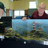 "Bob Gittingter of Lake Erie N-Scale Society and Randy Wolfe of Crooked River ""N"" Geneers in Cuyahoga County look at Gittingter's Lighthouse by the Ocean module at the Lake Metroparks Railroads in the Parks event.   Kristi Garabrandt - The News-Herald"