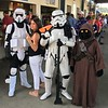 Fan poses with Storn Troopers and a Jawas