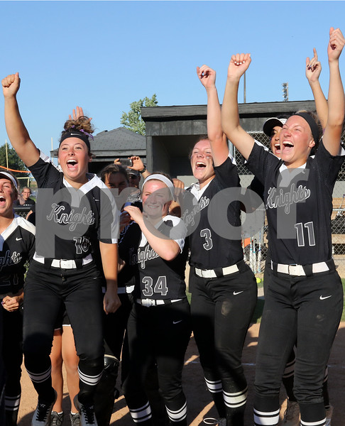 dc.sports.0604.kaneland softballCOVER
