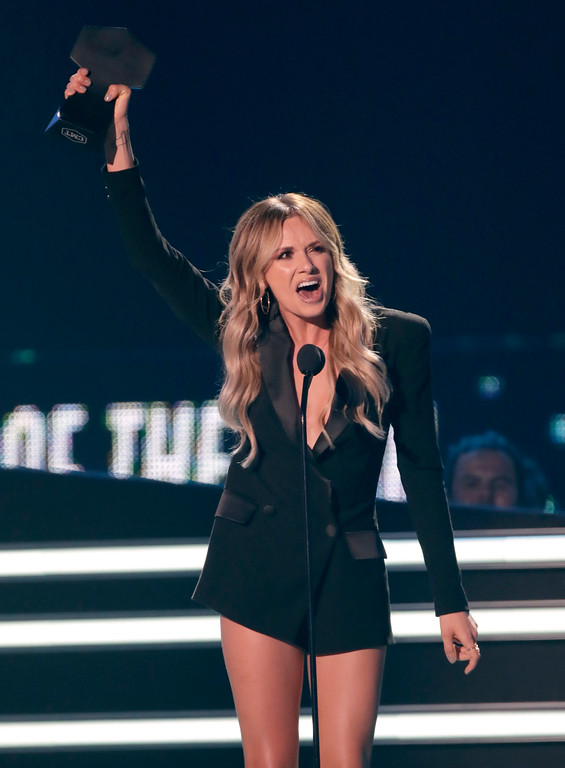 ". Carly Pearce reacts after accepting the breakthrough video of the year award for ""Every Little Thing\"" at the CMT Music Awards at the Bridgestone Arena on Wednesday, June 6, 2018, in Nashville, Tenn. (AP Photo/Mark Humphrey)"